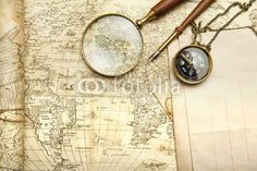 An  brass compass on a old map background