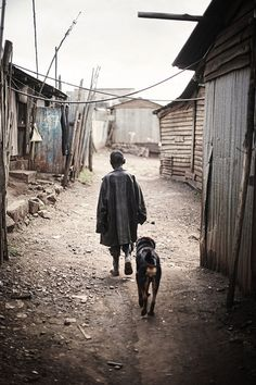 14-year old Daniel is one of many homeless children living in the slum in Nairobi, Kenya. He is joined by his faithful friend, Tuzo, who also keeps him warm at night.