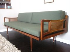 {Mid Century Modern sofa} love the caning detail of the arms & sleek cushions.