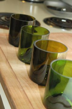 four eco-friendly stemless wine glasses made from recycled wine bottles via Etsy