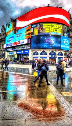 Piccadilly Circus, in the rain.