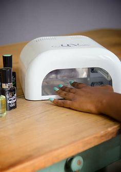 UV-NAILS • $69 ($249 value) for an at-home gel nail polish starter kit • Use included 36-watt UV lamp to cure nails • Comes with cuticle oil, base and top coats, and three gel polish colors
