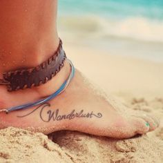 Wanderlust tattoo along aside of foot | Other Adventurous Tattoo Designs for Travel on same website.