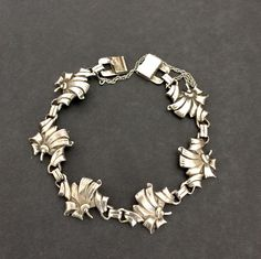 Sterling Silver Floral or Ribbon Link Bracelet Stacking Silver Bracelet Estate 1940's Pat. Unique Clasp Vintage Hallmarked Sterling http://ift.tt/1NgzWW4 #vintagejewelry #giftsforher #fashion #greatgifts #musthave #style #designersigned #repost #costumejewelry #vintagesterling #shopsmall #shopvintage #gifts4Her #MomBosses#shopetsy #plsfollow4updates #more2Come