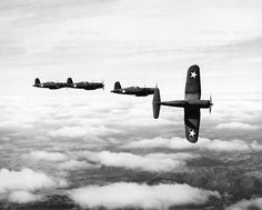 "F4U-1 Corsairs of Fighting Squadron VF-12: The section leader peels off from formation in this image showing F4U-1 Corsairs of Fighting Squadron VF-12 in flight on March 23, 1943. VF-12 was the first Navy squadron to receive the ""Bent Wing Bird"", which was the nickname for the single-engined American fighter instantly recognizable as the Vought F4U Corsair, with its inverted gull wings and seemingly too-long nose."
