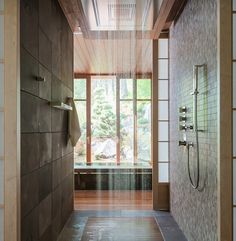 Contemporary bathroom with rain fall shower and outdoor view
