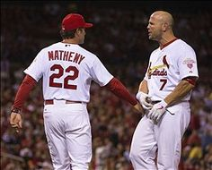 Mike Matheny holds back Matt Holliday as he argues a strikeout.  He is so hot when he is pissed! :) 9-19-12