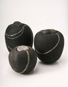 Ceramics by Kirsten Holm. Raku? They look like pebbles - worn away by water. Very organic. Love them