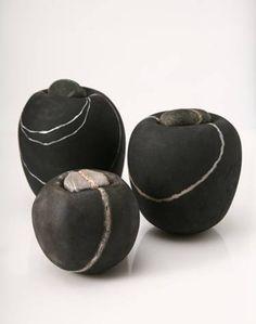 Ceramics by Kirsten Holm. Raku? They look like pebbles - worn away by water. Very organic. Love them