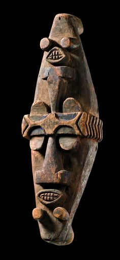 Africa | Water Spirit mask from the Ijaw people of Nigeria | Wood, with remains of red and indigo blue pigment | The masks are always worn horizontal on the head, for the water spirits themselves hold their heads in one level with the surface of the water as well.
