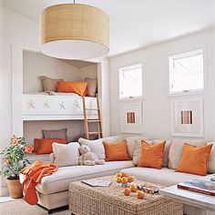 Love the splash of orange and the fact it's a multi-purpose room!