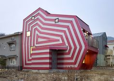 Somehow this house reminds me of a caravan. Maybe it's the stripes. By architect Moon Hoon, Lollipop House in Giheung-gu, in the Republic of Korea.