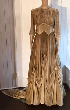 1930s Taupe Ombre Silk Velvet Wedding Gown Wax Flowers Train. Very flattering lines that fall to a full skirt that is gathered in six areas and adorned with little wax flowers. The back has a elegant length train. Front