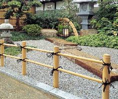 low bamboo fence to separate dog area, and to define 'asian garden' to left of lawn area