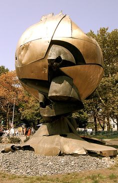 """Lower  Manhattan - """"The Sphere"""" AFTER 9/11 -This sculpture, conceived by the artist Fritz Koenig to represent world peace, stood in the plaza between the Twin Towers of the World Trade Center. It survived the destruction of the towers and now, damaged, stands in Battery Park in lower Manhattan. Battered, still standing."""