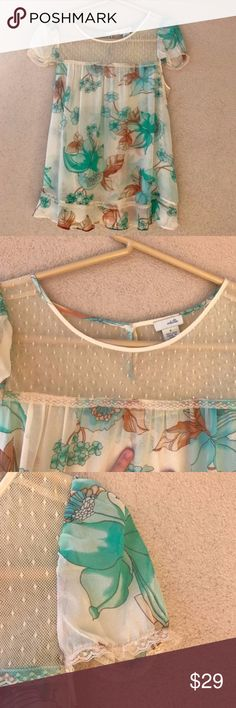 "Anthropologie Odille Floral Silk Lace Blouse Sz 4 Beautiful, 100% silk blouse by Odille from Anthropologie. This blouse has a delicate mesh neckline, a blueish green, turquoise floral pattern throughout, lace trim, and a ruffled bottom hem. Excellent condition with no flaws except the tiniest, barely noticeable dot in the last photo. - Size 4 - Approx. 19"" armpit to armpit - Approx. 25"" long - 100% silk - Closet ID # 0032 Anthropologie Tops Blouses"