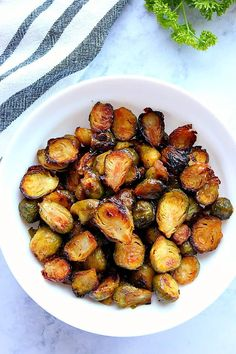 Honey Balsamic Roasted Brussels Sprouts Recipe - perfectly oven-roasted sprouts tossed with sweet and tangy honey balsamic combo just before serving. Make with fresh or frozen Brussels sprouts Frozen Brussel Sprouts Recipe, Healthy Brussel Sprout Recipes, Freezing Brussel Sprouts, Balsamic Brussel Sprouts, Roasted Sprouts, Brussels Sprouts, Roasted Vegetables, Sprouts Food, Asian Vegetables