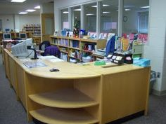 Love having display space worked into the circ desk - Keota Library