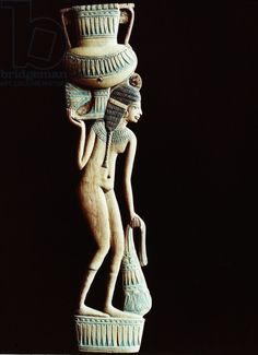 A cosmetic spoon in the form of a naked young woman carrying an amphora on her shoulder and a bag