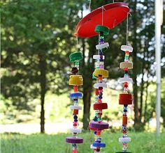 If you're searching for fun and adorable recycled craft ideas, you'll love this Bottle Cap Art Wind Chime. Whether you're overfilled with milk jug, soda bottle, or coffee lids, this simple craft idea will help you use them all up in a creative way. Recycling Projects For Kids, Recycled Crafts Kids, Recycled Art Projects, Recycled Materials, Craft Projects, Diy Arts And Crafts, Crafts To Do, Easy Crafts, Children Crafts