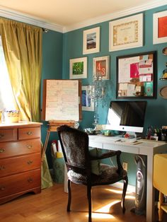Great teal color on the wall?  Check!  Fantastic mix of #custom-framed pieces with perfect accent colors? Check An inspirational office space? Check... I want an office like this.