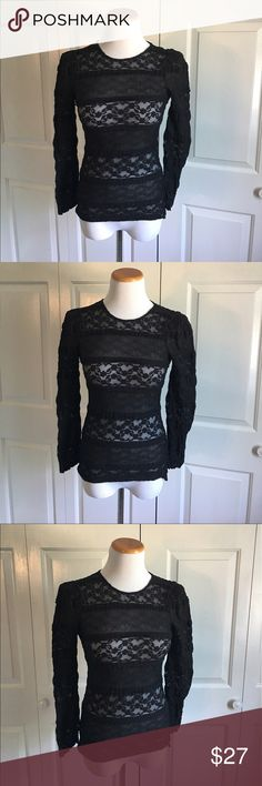 Zara Woman Black Lace Top Black lace top with shoulder pads. Excellent condition, no flaws. Could fit a small IMO too. Zara Tops Blouses