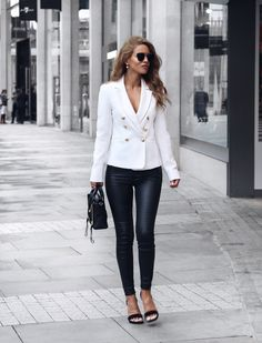 """justthedesign: """"Nada Adelle is ultra glamorous in this spring style, consisting of leather leggings paired with a gorgeous white double-breasted blazer. With gold buttons and a plunging neckline, this blazer is perfect for dressing up. Blazer: Miss..."""