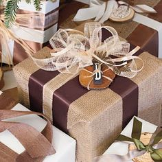 Burlap Gift wrap Use brown ribbon for guys gifts and maybe brown paper instead of burlap.