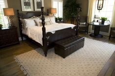 Centered Around A Chocolate Brown Four Post Bed Ced By Matching Leather Ottoman This