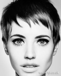 Hair was cut into a pixie crop. It was finished with wax to create texture through the fringe area.
