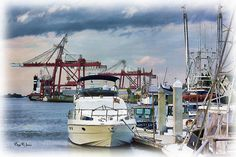 """This is a digital painting titled """"Amelia Island Boat Dock."""" Digital Art techniques were applied to simplify the image, soften colors, add texture and provide a painterly feel to the piece."""