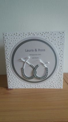 Paved pearl technique along with die cut horse shoes and circles make up this large personalised card.