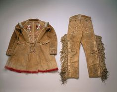 Métis coat and trousers c. 1850  Hide, porcupine quill, bone, copper, silver tassels, wool.  The Métis, a culture resulting from a cross between Cree and French cultures, flourished in the Red River area of Manitoba. In this work we see this fusion in the highly tailored coat and trousers with a porcupine-decorated smoked moose hide. Traditional fringes along the trouser leg are similar to those on Plains-style leggings.