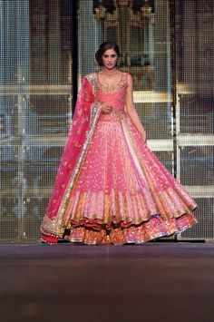 This is so princess like! Beautiful pinks, and a stunning umbrella skirt. --- #indian #wedding #bride --- Manish Malhotra inspiration