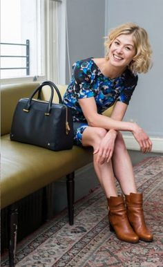 As seen in the Telegraph: Rosamund Pike with the L.K. Bennett bag she designed, the L.K.Bennett Dionne Boots and Poppy Dress.