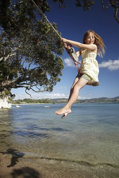 flying on a rope swing, along the waters edge.. ahh