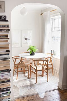 White tulip dining table | Inside The Everygirl Cofounder's Inspiring Apartment
