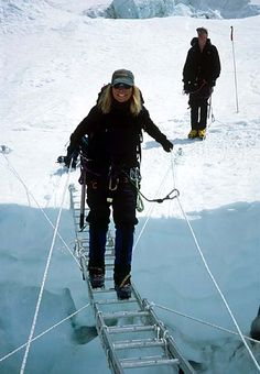 Susan Ershler on a ladder in the Khumbu Icefall on Mt.Everest.