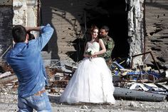 Homs, SyriaNewly-wed Syrian couple Nada Merhi,18, and Hassan Youssef,27, have their wedding pictures taken in front of a heavily damaged building