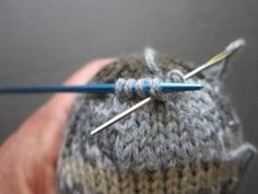 Repairing a hand-knit sock with a knit-in-place patch