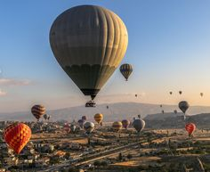 Sunrise with dozens of balloons Photo by Cihan Acar -- National Geographic Your Shot