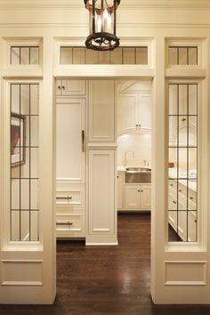 Formal butler's pantry behind leaded glass entry. Murphy & Co. Design.//Beautiful!