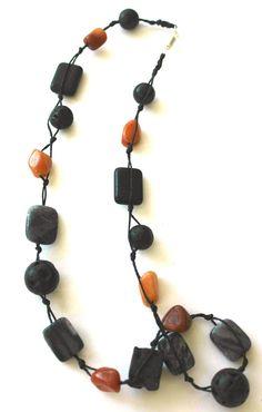 Black Lava and Orange Stones Single Strand Necklace https://www.etsy.com/listing/218612546/lava-stones-necklace   $15.00 #stonejewelry #handmadejewelry #lavanecklace #blacknecklace #lavastones #stonenecklace