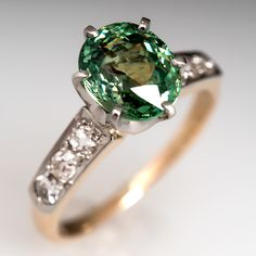 Antique Demantoid Garnet Ring Crown Head 14K Gold & Platinum centered with a 2.39 carat oval cut natural green garnet