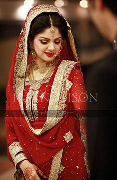 Indian bride wearing bridal salwar and jewelry. #IndianBridalHairstyle #IndianBridalMakeup