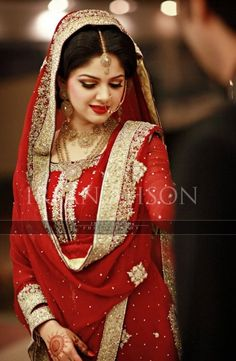 Indian bride wearing bridal salwar and jewelry. #IndianBridalHairstyle #IndianBridalMakeup