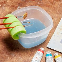 Nifty Paintbrush Holder  Keep your watercolor brushes dry and handy! Cut a short section of pool noodle, slice it part of the way through and insert brushes.