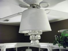 Fandelier---Standard white ceiling fan light gets a new look simply by adding a lamp shade and a hanging tealight chandelier.