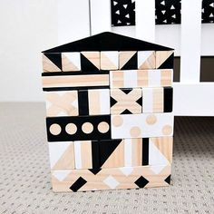 Building blocks and wooden toys have never been more fun! This stunning set of Australian handcrafted and hand painted black-and-white wooden blocks make building a house tons of fun for everyone.