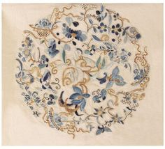 Chinese Rug, China, Late 19th Century - Luminescent flowers, gilt vine scrolls and graceful botanical motifs are artfully combined in a harmonious medallion. Elegant butterflies, a traditional symbol of joy, love and longevity, appear throughout the naturalistic medallion along with sylvan branches and graceful scrolling tendrils.